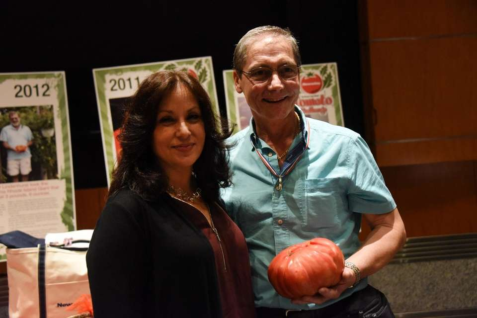 Alberto Oppedisano, right, with Newsday's Jessica Damiano, received