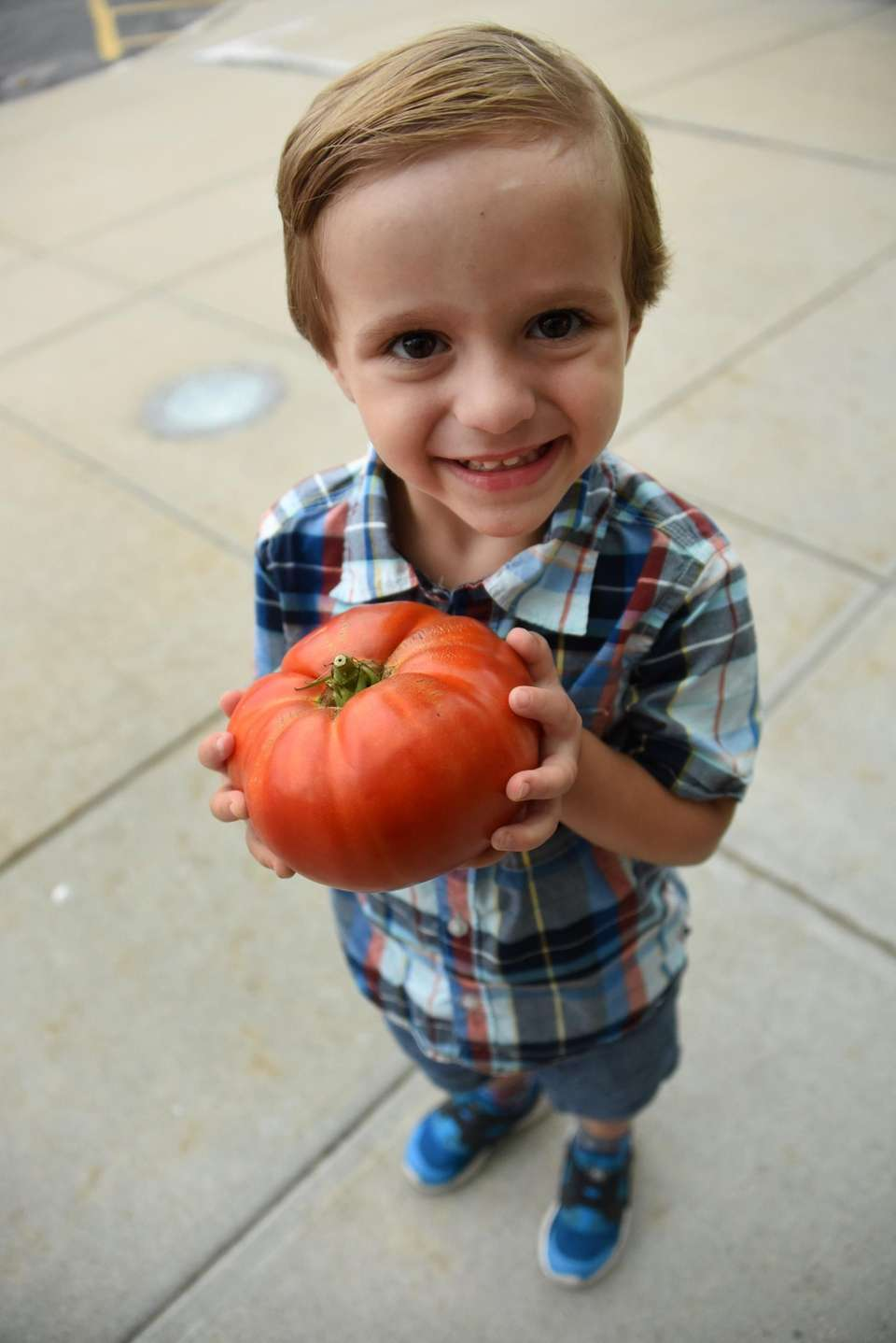 Wyatt DePace, 3, of Albertson, shows off his