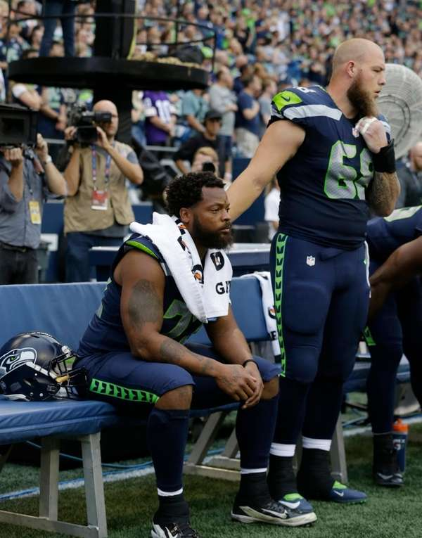 Michael Bennett sits on the bench during the