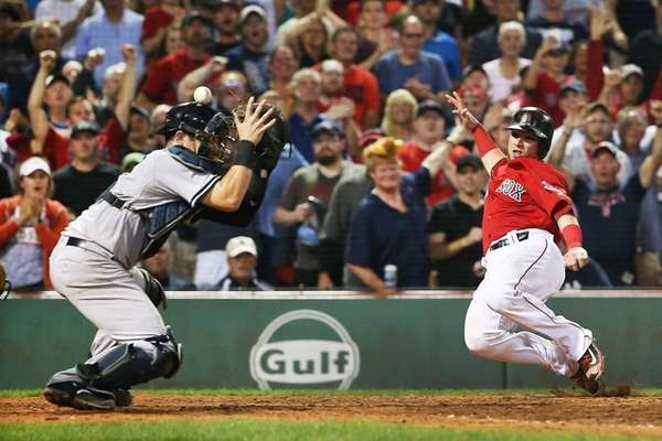 Christian Vazquez of the Boston Red Sox slides