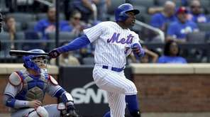 Curtis Granderson of the Mets follows through on