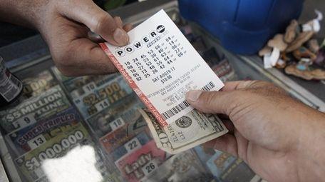 Joe Corbett of Medford buys a Powerball ticket