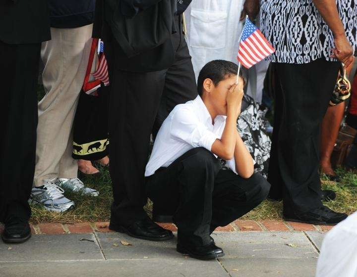 A young mourner pays tribute during the funeral