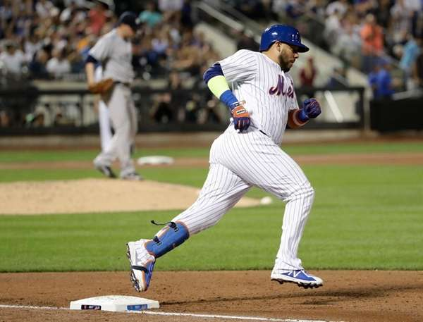 Mets' Rene Rivera runs the bases after