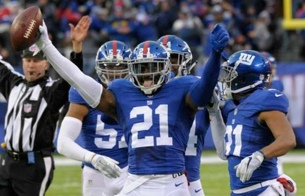 Landon Collins celebrates after intercepting a pass by