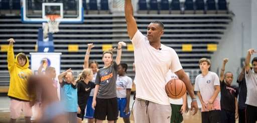 Former New York Knicks star Allan Houston speaking