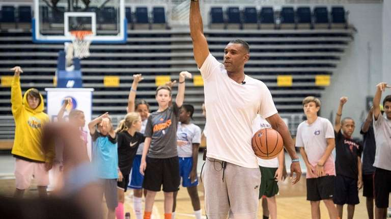 Former New York Knicks star Allan Houston speaking