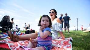 Addison Golynsky, 18 months, of Port Washington, noshes