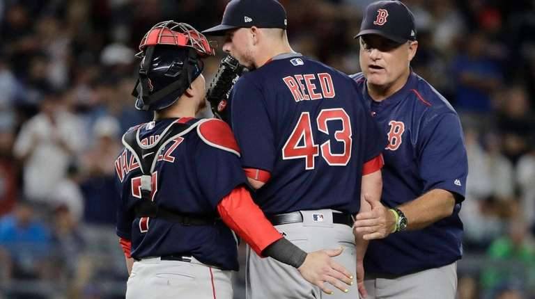 Red Sox manager John Farrell, right, takes reliever