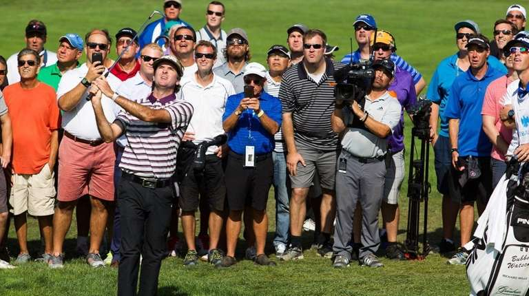 Bubba Watson hits out of the gallery on