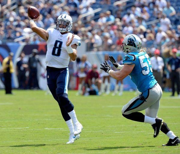 Tennessee Titans quarterback Marcus Mariota passes as he