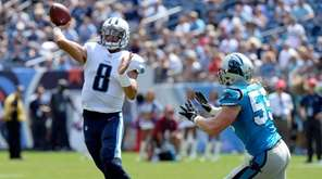 Tennessee Titans quarterback Marcus Mariota passes as he
