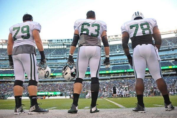 New York Jets teammates Brent Qvale, left, Jeff