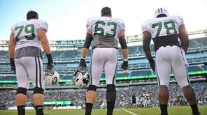 New York Jets teammates Brent Qvale, left, Jeff
