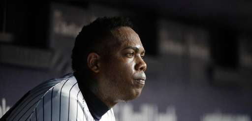 New York Yankees relief pitcher Aroldis Chapman sits