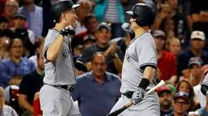 New York Yankees' Todd Frazier, left, is congratulated