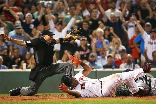 Rafael Devers of the Boston Red Sox slides