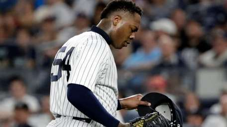 Aroldis Chapman reacts after he was taken out