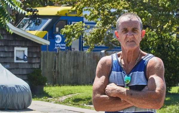 Bob Goodhue stands on his front lawn in