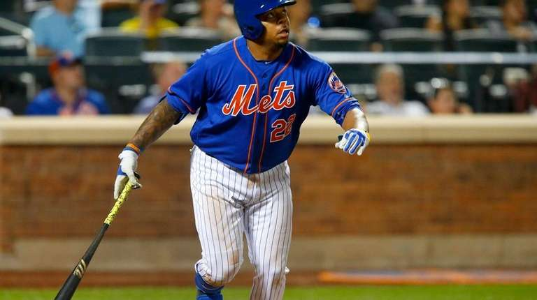 Dominic Smith of the Mets hits a home