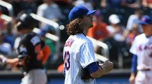Mets starting pitcher Jacob deGrom looks away as