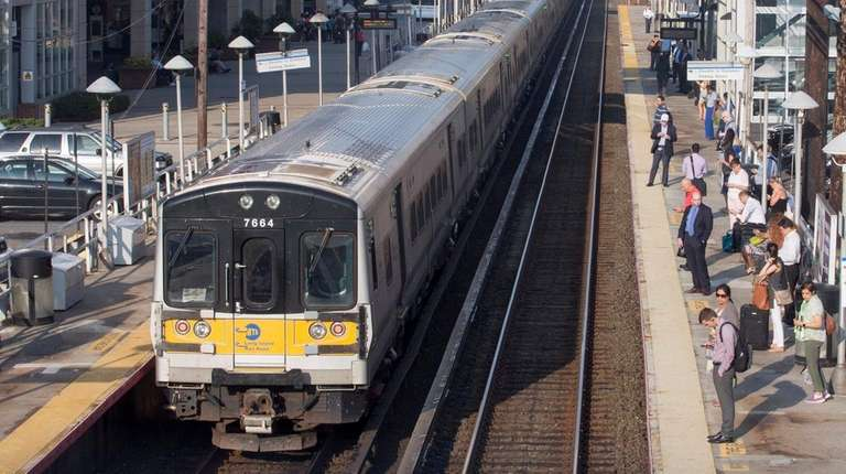 Commuters board a westbound LIRR train on Tuesday,