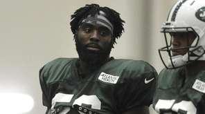 Demario Davis #56, left, practices during New York