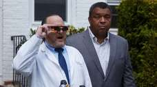 Dr. Dean Hart, left, Holding special glasses to