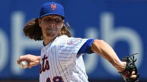 Mets starter Jacob deGrom delivers a pitch