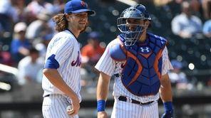 Mets catcher Travis d'Arnaud talks with Jacob deGrom
