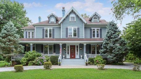 Original moldings, hardwood floors, built-ins and four fireplaces