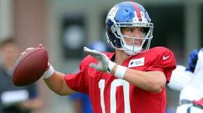 Giants quarterback Eli Manning throws a pass during training