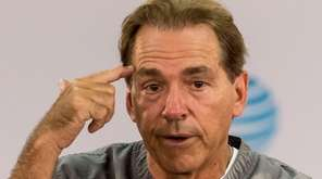 Alabama football coach Nick Saban talks with the