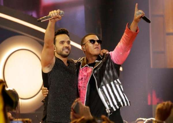 Luis Fonsi, left, and Daddy Yankee put their
