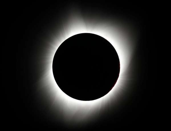 The moon covers the sun during a total