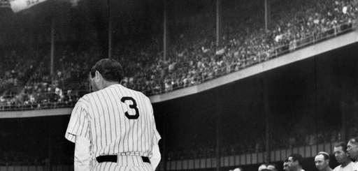 Home run king Babe Ruth, wearing his famed