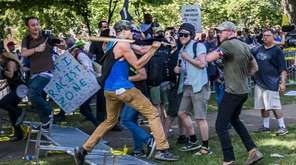 White supremacist groups and counter-protesters clash at a