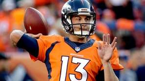 Denver Broncos quarterback Trevor Siemian warms up prior