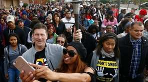 As Phoenix Mayor Greg Stanton, left, holds the