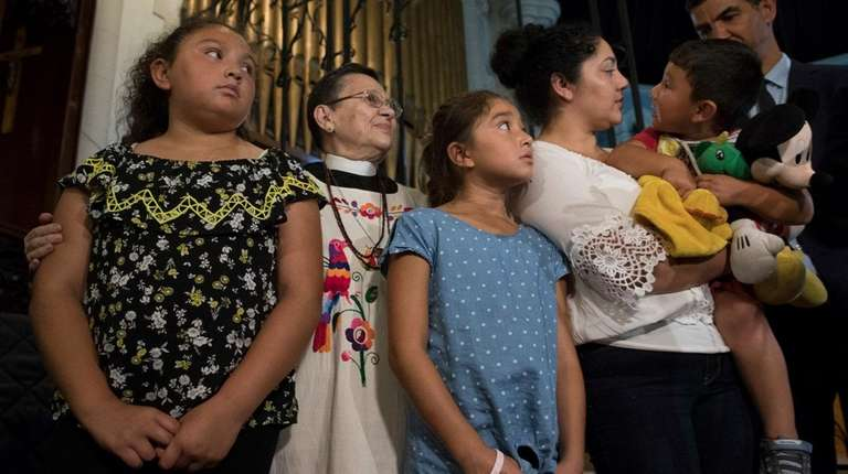The Reverend Maria Santiviago, second from left, assistant