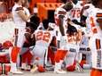 Members of the Cleveland Browns kneel during the