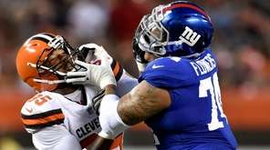 New York Giants offensive tackle Ereck Flowers stops