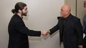 Billy Joel presents a $20,000 award to Bellmore