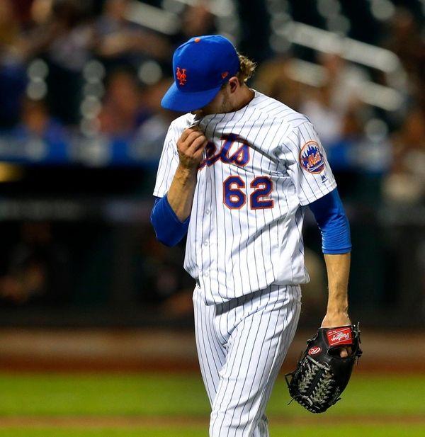 Erik Goeddel of the Mets walks to the