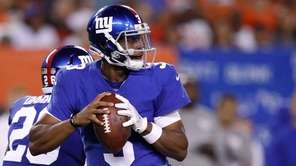 Geno Smith of the Giants looks to pass