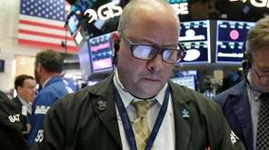 Trader Jeffrey Vazquez on the floor of the
