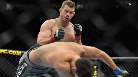 Nate Marquardt, left, knocks out Demian Maia in