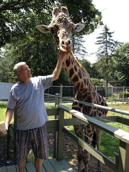 My husband Ralph with Clifford the Giraffe at