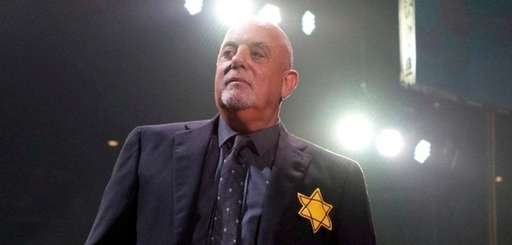 Billy Joel wore a bright yellow Star of