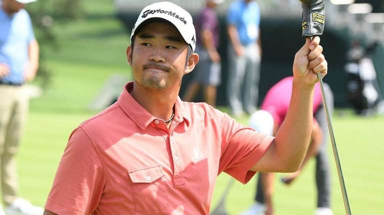 Golfer John Huh gestures from the putting green
